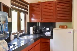 A kitchen or kitchenette at Playa Palms Beach Hotel