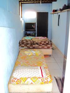 A bed or beds in a room at Suíte na Serra