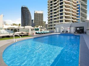 The swimming pool at or near Victoria Square 2 Bed Ocean View Broadbeach
