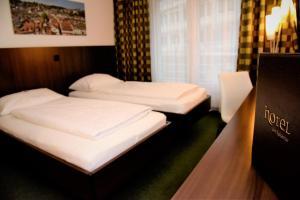 Кровать или кровати в номере Hotel am Spisertor