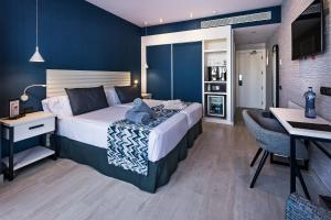 A bed or beds in a room at Catalonia Ses Estaques - Adults Only