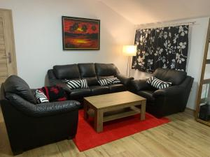 A seating area at Apartamenty Podwarszawskie
