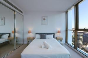 A bed or beds in a room at Premium location in Darling Harbour ICC & Free Carpark