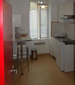 Cuisine ou kitchenette dans l'établissement Appartement d'Hôtes
