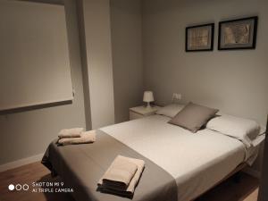 Cama o camas de una habitación en Apartamento moderno en pleno centro de Castellón.