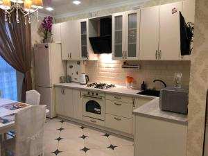 A kitchen or kitchenette at VIP Аппартаменты