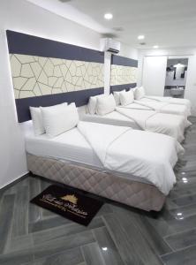 A bed or beds in a room at VILA DAS ACÁCIAS