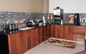 A kitchen or kitchenette at Foxwood Inn and Suites