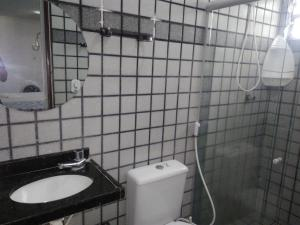 Um banheiro em Pousada Temporada Maceió
