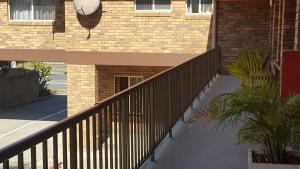 A balcony or terrace at Royal Palms Motor Inn