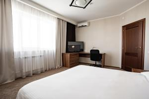A bed or beds in a room at Resident