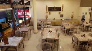 A restaurant or other place to eat at The Flora Kuta Bali