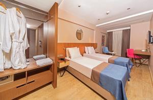 Кровать или кровати в номере Redmont Hotel Nisantasi