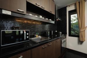 A kitchen or kitchenette at Kamala Villa Hill