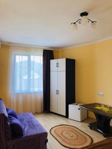 Кровать или кровати в номере Guest house berendei2000