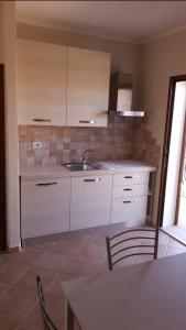 Cucina o angolo cottura di Il Borgo - Porto Pollo