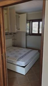 Letto o letti in una camera di Il Borgo - Porto Pollo
