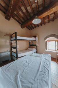A bunk bed or bunk beds in a room at Ostello Bello Assisi Bevagna