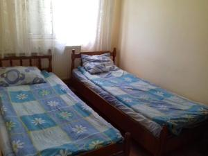 A bed or beds in a room at Baile Baita