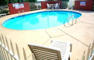 The swimming pool at or near Rest Inn Fort Smith