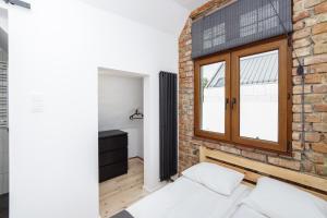 Łóżko lub łóżka w pokoju w obiekcie Sopotel
