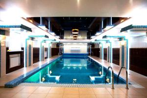 The swimming pool at or close to Abnicum Business Hotel