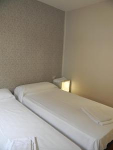 Cama o camas de una habitación en Pension Obel