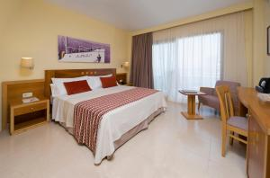 A bed or beds in a room at Bellamar Hotel Beach & Spa