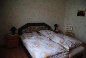 Ein Bett oder Betten in einem Zimmer der Unterkunft Gut Dankerode