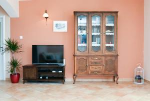 A television and/or entertainment center at Villa Sun