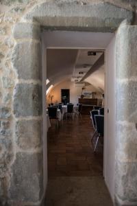 Restaurant ou autre lieu de restauration dans l'établissement La SCIC du Château de Poët-célard