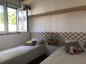 A bed or beds in a room at Pousio-Bungalows&Camping