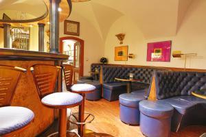 The lounge or bar area at Royal Ricc