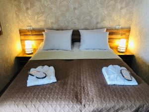 A bed or beds in a room at Paradise Kazbegi