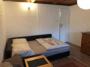 Łóżko lub łóżka w pokoju w obiekcie Rytel Zapora 36