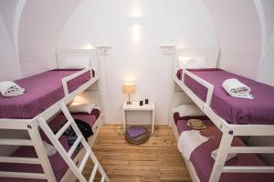 A bunk bed or bunk beds in a room at Lost Inn Lisbon Hostel