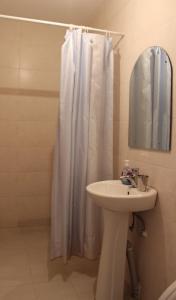 A bathroom at HQ of Nove Sujashvili