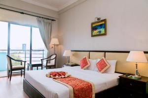 Giường trong phòng chung tại Seagull Hotel