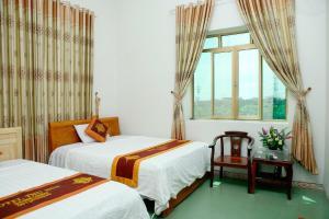 Giường trong phòng chung tại Khách Sạn Thu Nga