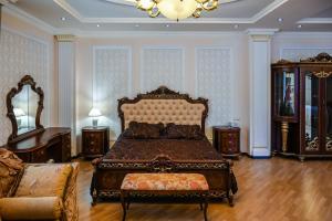 Кровать или кровати в номере RichMan