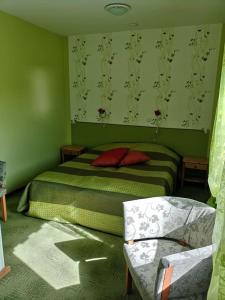 Voodi või voodid majutusasutuse Kõrtsialuse külalistemaja toas