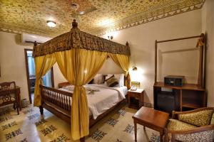 A bed or beds in a room at Nirbana Heritage Hotel and Spa