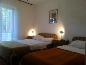 A bed or beds in a room at Guesthouse Curin