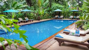 The swimming pool at or near Chateau d'Angkor La Residence