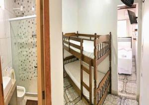 A bunk bed or bunk beds in a room at Pousada Ninho da Coruja