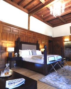 A bed or beds in a room at Tulloch Castle Hotel 'A Bespoke Hotel'