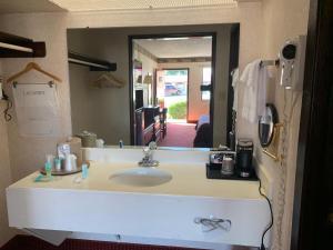 A bathroom at Regency Inn