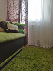 A bed or beds in a room at Апартаменты LikeHome