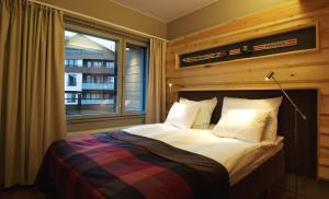 A bed or beds in a room at Levi Suites Unna Mànnu