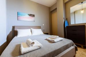 A bed or beds in a room at Martimi Apartments